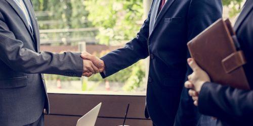 Japanese businessmen having an agreement